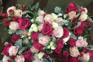 $175.00 - $65.00 per additional bouquet/boutonniere
