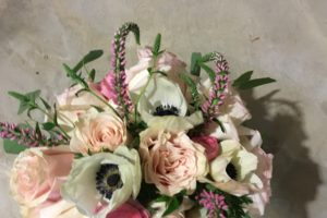 White anemone, O'Hare and soft pink roses, pink veronica, pink ranunculus, white hydrangea and silver dollar eucalyputs.